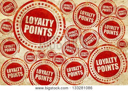 loyalty points, red stamp on a grunge paper texture