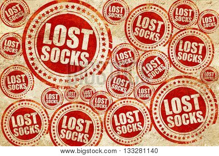 lost socks, red stamp on a grunge paper texture