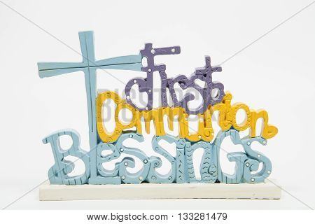 A first communion decoration against a white background