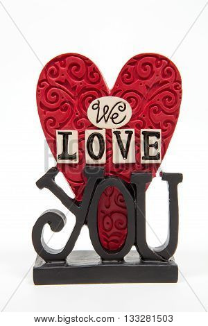 A we love you decoration against a white background