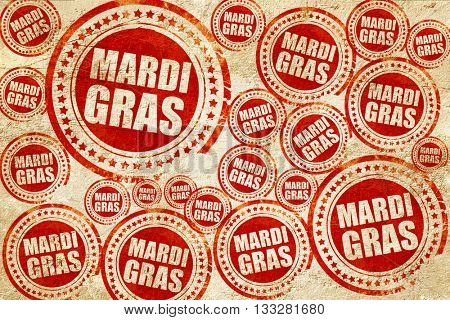 Mardi Gras, red stamp on a grunge paper texture