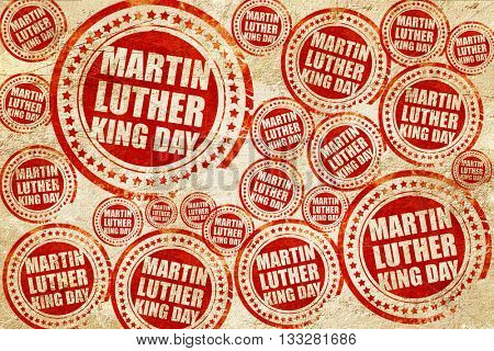 martin luther king day, red stamp on a grunge paper texture