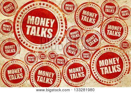 money talks, red stamp on a grunge paper texture