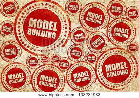 model building, red stamp on a grunge paper texture