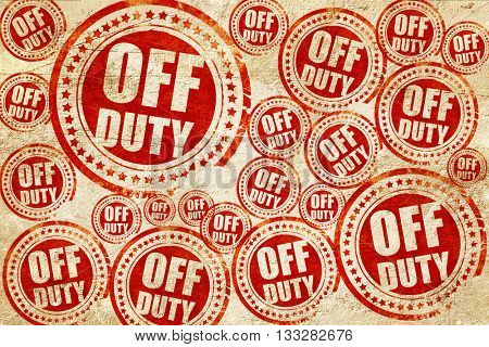 off duty, red stamp on a grunge paper texture
