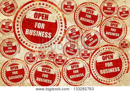 Open for business sign, red stamp on a grunge paper texture