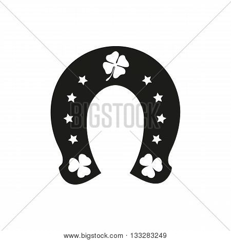 Horseshoe and four or three leaf clover - lucky symbol on a white background