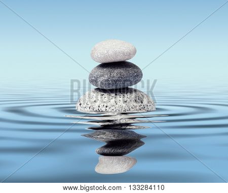 Zen stones in water with reflection - peace balance meditation relaxation concept