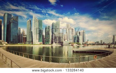 Travel Singapore - vintage retro effect filtered hipster style image of Singapore skyline of business district and Marina Bay panorama. Ultra wide angle