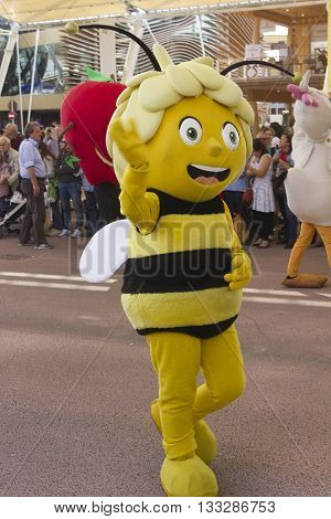 MILAN, ITALY - OCTOBER 12 2015: Foody daily Parade at Expo 2015 Universal exhibition on the theme of food held in Italy from May to October 2015. Detail of honeybee puppet