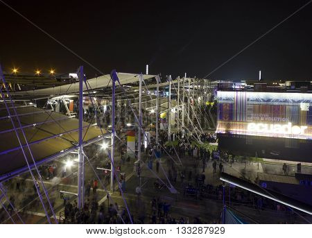 MILAN, ITALY - OCTOBER 12 2015: View from the top of Expo 2015 area at night with its pavilion and main promenade. Expo was held in Milan from May to October 2015