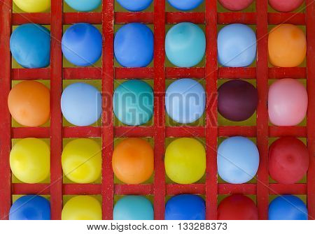wooden stand with multicolored balloons. amusement throwing darts at balloons. colorful background