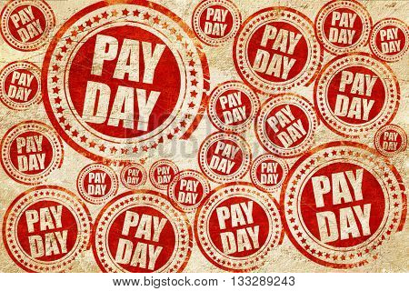 pay day, red stamp on a grunge paper texture