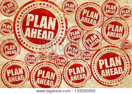 plan ahead, red stamp on a grunge paper texture