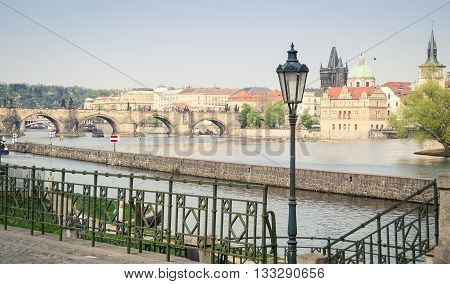 Prague with the view of Charles Bridge and the Vltava river.