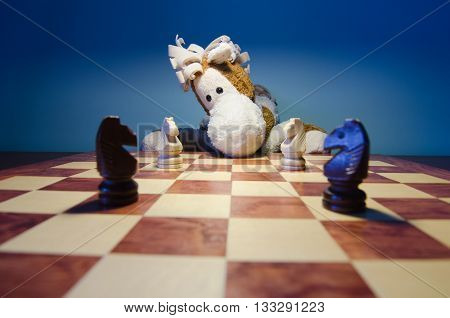 toy horse, chess board and four horses