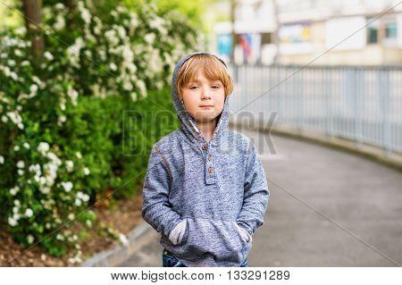 Fashion portrait of adorable little boy of 4-5 years old wearing blue sweatshirt