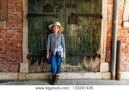 Outdoor portrait of adorable little girl of 7-8 years old, little kid travel in Italy