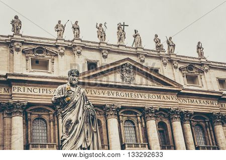 Saint Peter sculpture in Vatican city square in front of basilica, fade effect.