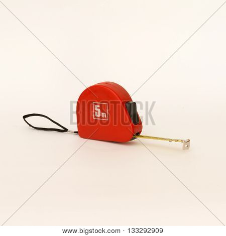 Tape measure in a red carrying case for measuring length