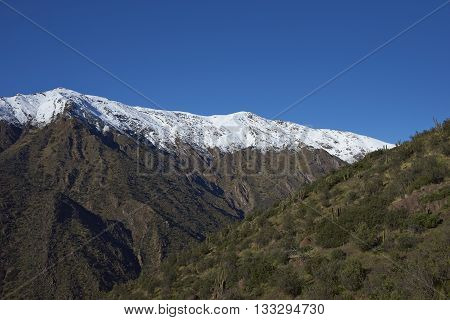 Snow covered mountains in Parque Puente Nilhue in the foothills of the Andes Mountains surrounding Santiago, capital of Chile.