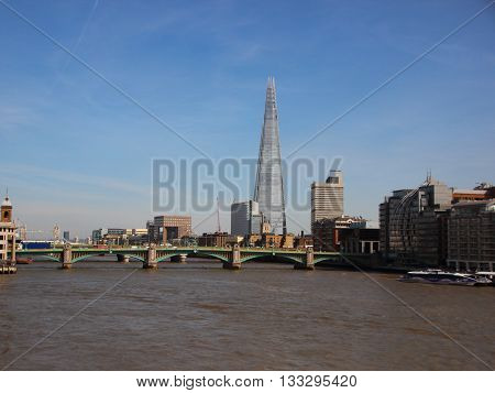 River Thames with The Shard Tower in Blue Sky Background