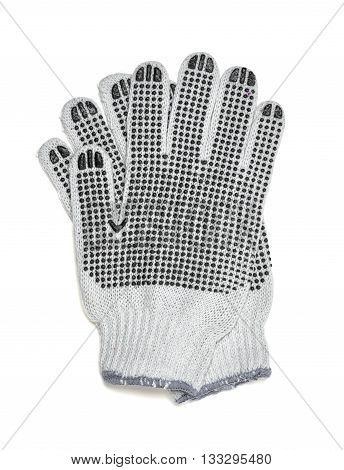 Cut-out pair of white knitted gloves with rubber-covered side. Protective gloves for working by hands. Cover and hand-protection. Gardening. Type of clothing. Close-up photo