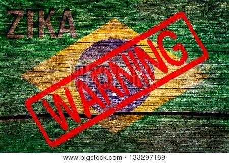 Brazil flag painted on the old cracked wood with word zika and warning alert the virus infection risk