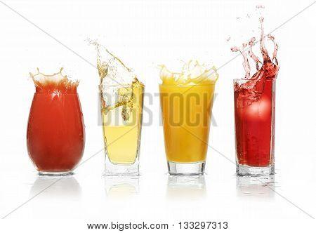 Fruit juices splash isolated on white studio shot