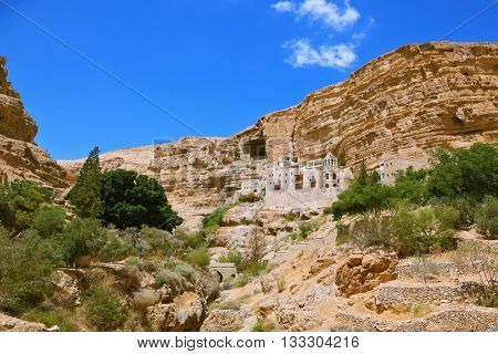 The famous Orthodox monastery of St. George. The building of the monastery was built on the wall of the gorge of Wadi Kelt. Israel
