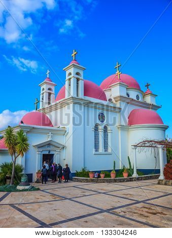Greek church of the Cathedral of the twelve apostles. Pink domes and golden crosses crowned with snow-white church building