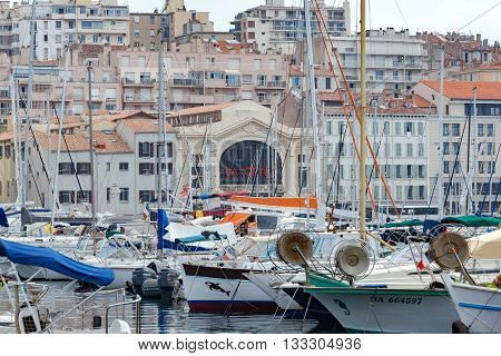 Marseille, France. July 2015. The old port of Marseille with a series of old buildings, bars and shops surrounding the harbor.