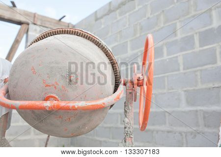 the new orange cement mixer at a construction site.