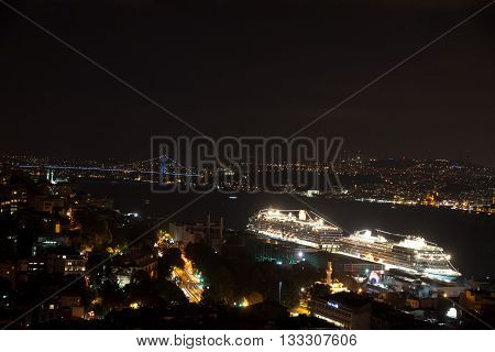 Istanbul skyline from Galata bridge by night with cruise liners and other ships. Istanbul, Turkey