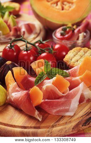 Prosciutto di Parma with melon, figs and tomato