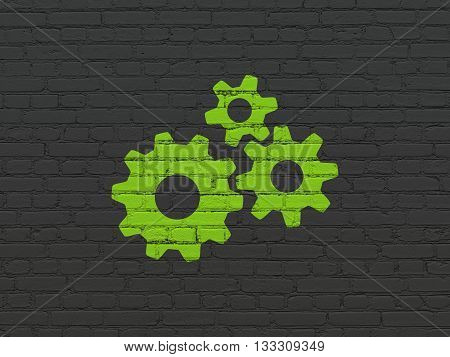 Web development concept: Painted green Gears icon on Black Brick wall background