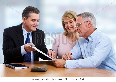 Senior couple with insurance agent.