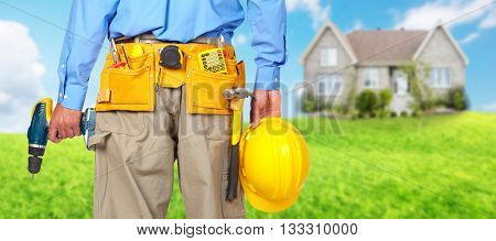 Construction worker with helmet and drill.