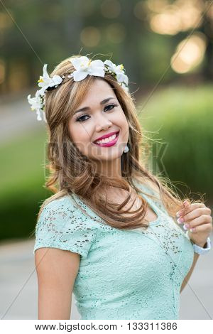 Bride at her wedding with a flower headband