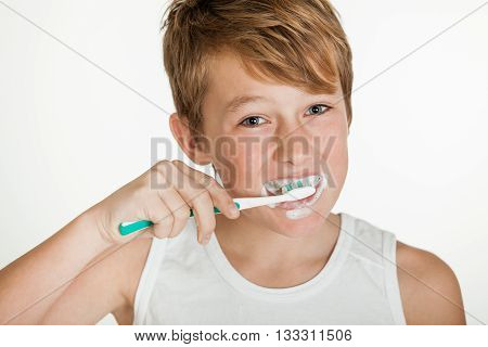 Smiling Teenage Boy Wearing Brushing Teeth