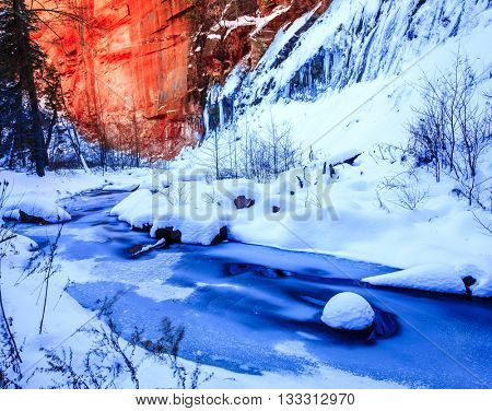 Ice and snow over Oak Creek on West Fork Trail near Sedona, Arizona