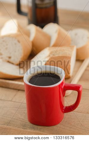 Americano In Red Cup With Sliced Bread On Wooden Background