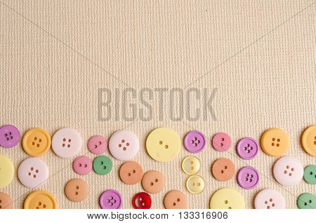 Colorful Cloth Button On Beige Paper Background
