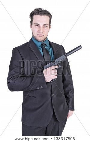 Handsome man holding gun. Isolated on white background.