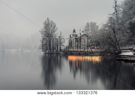 Bled lake in the morning, Slovenia. Fog over the city. Famous place in the mountains