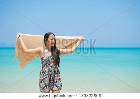 Woman On Tropical Beach With Sarong.