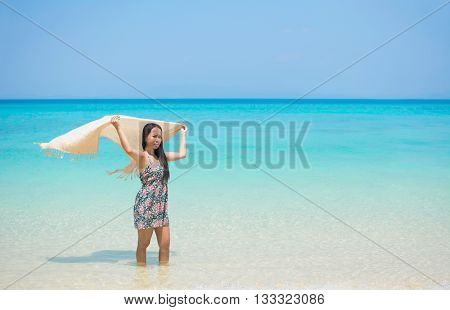 Woman Holding Sarong In Wind On Paradise Beach.