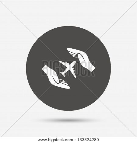 Flight insurance sign icon. Hands protect cover plane symbol. Travel insurance. Gray circle button with icon. Vector