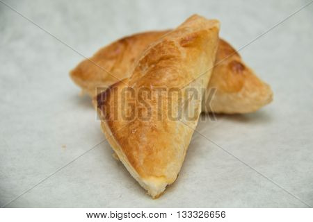 Puff pastry pie with curry chicken on white