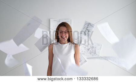 Cute office worker with throwing away papers, with laugh